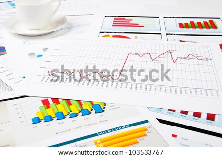 papers and charts of successful business, workplace of the businessman