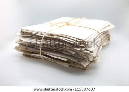 papers piled up on a white fund
