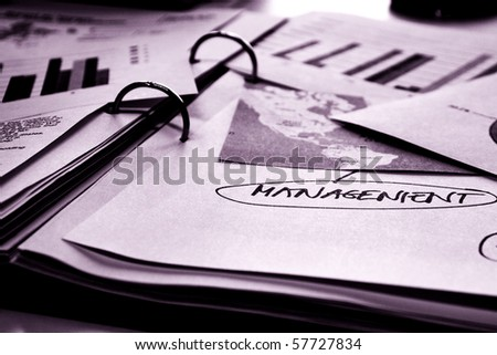 Papers with maps and graphs in binder
