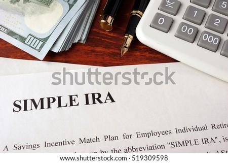 Papers with simple ira and book on a table. #519309598