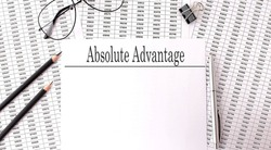 Papers with text, ABSOLUTE ADVANTAGE on the table, business concept.