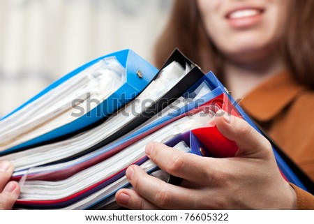 Paperwork - human hand holding business paper file