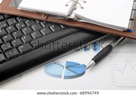 paperwork in office and computer keyboard showing success