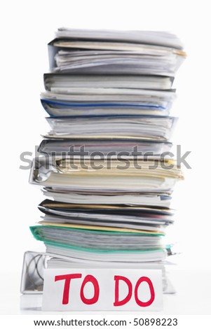 Paperwork to do concept with to do word in front of pile of paper. Selective focus