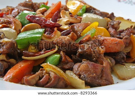 Paprika chicken with peppers and cashew nuts traditional chinese cuisine