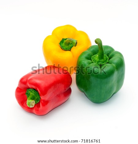 Paprika (pepper) vegetables on white background. Red, yellow and green one.