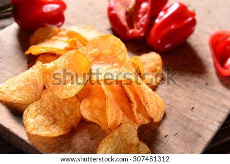 Paprika Potato Chips on rustic background