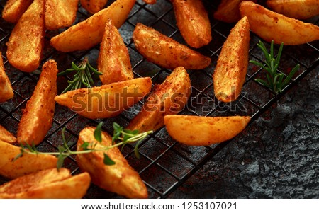 Paprika potato wedges fries chips, with ketchup and thyme Stock photo ©