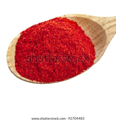 paprika powder spices on spoons isolated on a white background