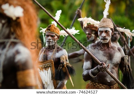PAPUA IRIAN JAYA ASMAT PROVINCE INDONESIA JANUARY 18 Asmat headhunters display traditional and national tribal customs dresses and weapons on January 18 2009 in Papua Irian Jaya Asmat Province Indonesia