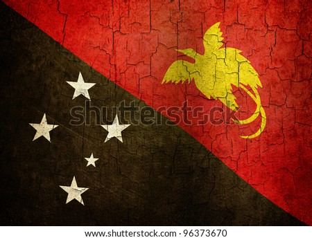 Papua New Guinea flag on a cracked grunge background