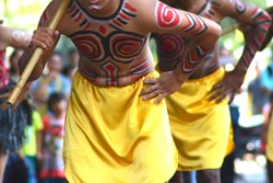 Papua traditional dancers. Unique costume, body and face painting, feather headdress, axe