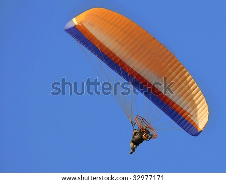 Para glider with propelling flying in the sky