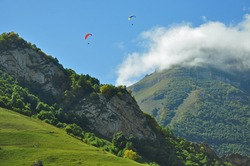 Para gliders flying in mountains