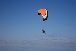 para-motor glider flyes in the air