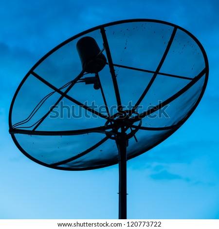 Parabolic beautiful satellite dish in twilight