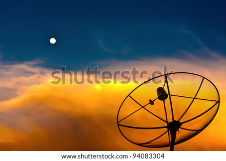 Parabolic satellite dish in twilight time with blue sky and moon