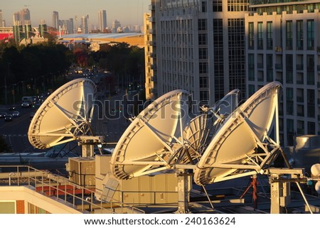 Parabolic satellite dish space technology receivers over the city, Toronto, Canada #240163624