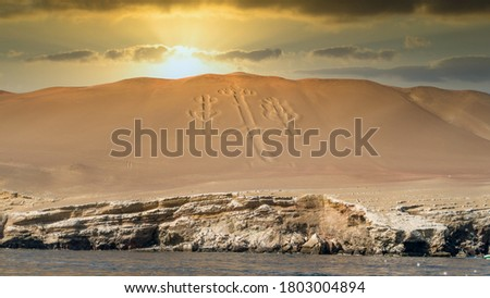 Paracas, Peru - September 2017: Ancient large scale candelabrum figure in Paracas national park during sunset Stockfoto ©