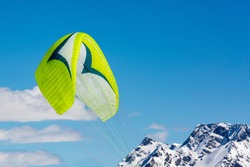 Parachute against the background of mountains and blue sky