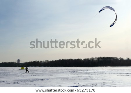 Parachute Surfing in Winter - stock photo