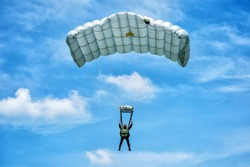Parachute training with blue sky