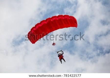 parachuter descending with a...