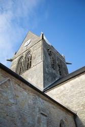 Parachutist hanging on church in Sainte Mere Eglise