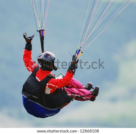 Parachutist in action