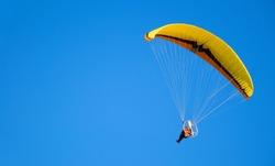 parachutist in the blue sky