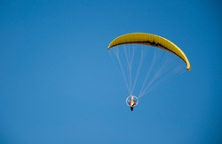 parachutist in the blue sky