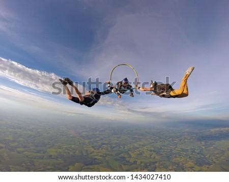 Parachutist inside the hula hoop in free fall. #1434027410