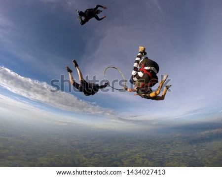 Parachutist inside the hula hoop in free fall. #1434027413