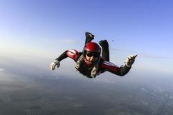 Parachutist prepares to open the parachute.