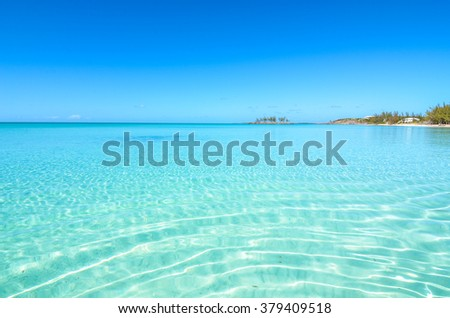 Stock Photo Paradise beach on Eleuthera (Bahamas) with crystal clear water.