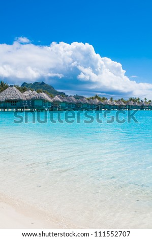 Paradise beach with bungalows