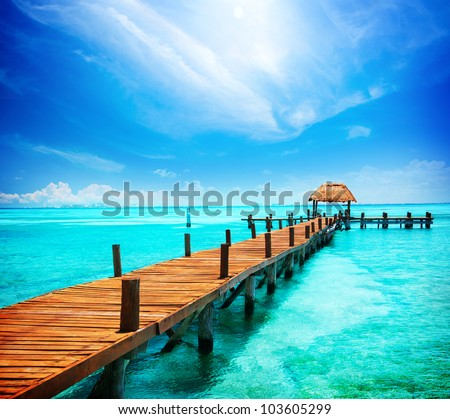 Paradise. Vacations And Tourism Concept. Tropical Resort. Jetty on Isla Mujeres, Mexico,Cancun - stock photo