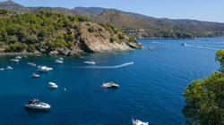 Paradisial bays, blue sea, purely water, moorages with boats and yachts on mountains and sky background. Amazing resort destination. Mediterranean resort in a wonderful bay on a sunny day.