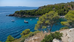 Paradisial bays, blue sea, wonderful goldish-sandy beaches with purely water, moorages with boats and yachts. Amazing resort destination. Mediterranean resort in a wonderful bay on a sunny day.
