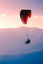Paraglide in a sky above Carpathian mountains