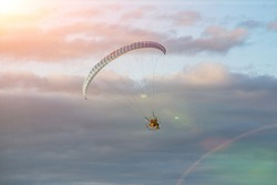 paraglide with a motor high in the sky