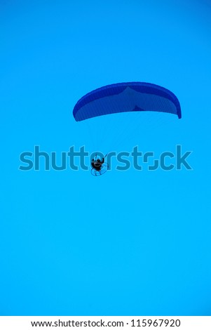 Paraglider - Feeling free on the blue sky - stock photo
