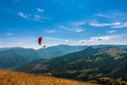 Paraglider flies over the Dolomites to infinity