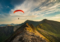 Paraglider flying along Crib Goch