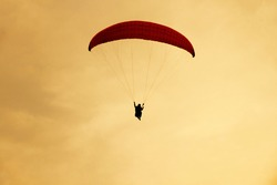 Paraglider flying in the sky