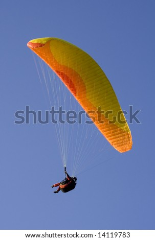 Paraglider in mid-air action
