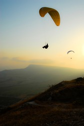 Paraglider in the evening sky