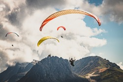 Paraglider in the mountains. Paragliding in the Dolomites. Paragliding in the Alpes