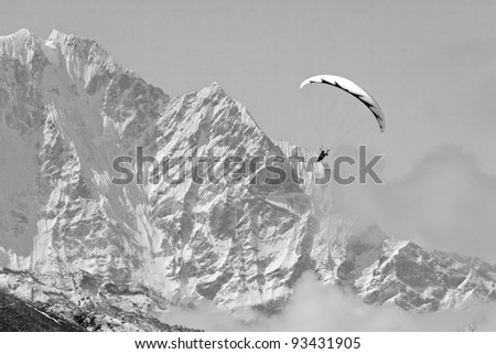 Paraglider near peak Lhotse (8516 m) - Chhukhung, Nepal, Himalaya (black and white)
