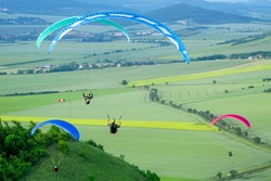Paraglider. Parachuter. Paragliding in mountains. Paragliding sport.Parachute jumper.Parachute. Extreme sports activity